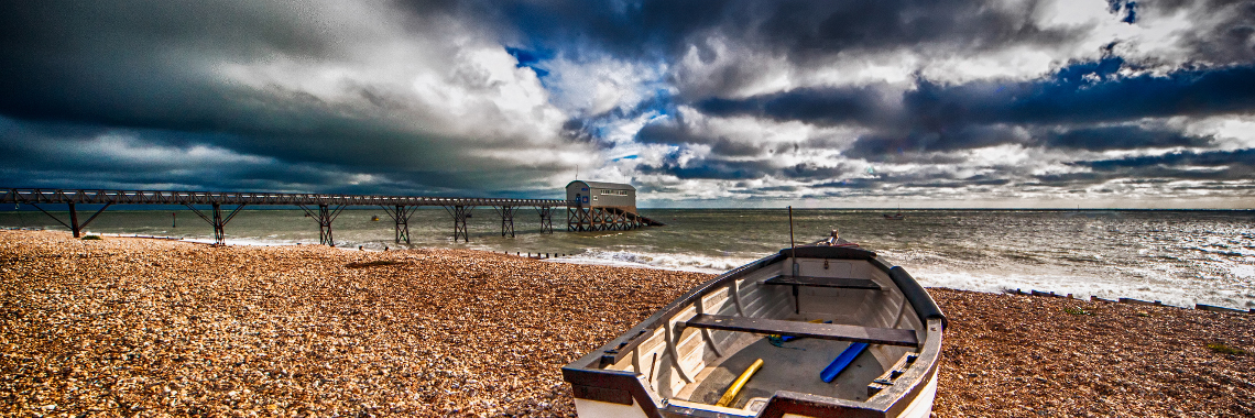 Web slider Boat with dramatic sky