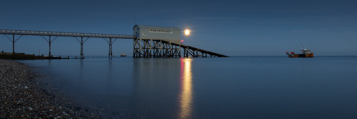Web Slider Lifeboat station with fishing boat